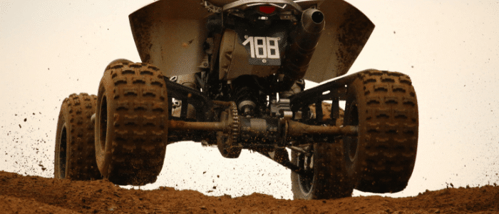 ATV coming over a dirt hill