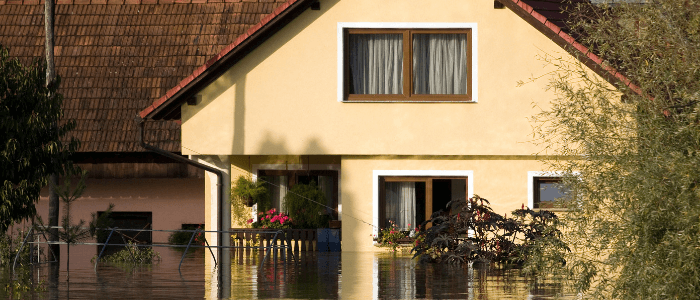 Home exterior with flood waters covering half of the first story
